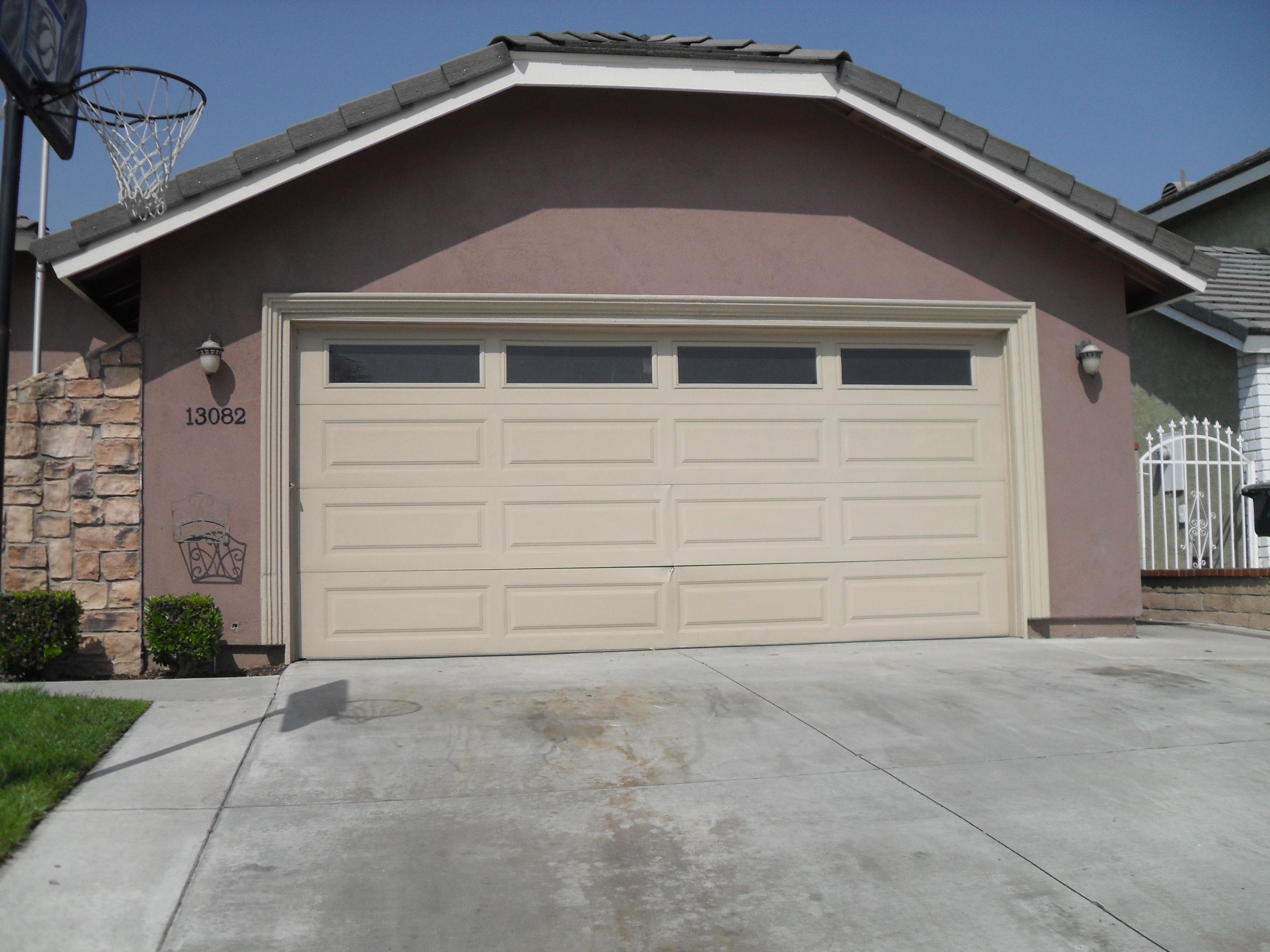 Photo gallery absolute garage doors for Long beach garage door repair